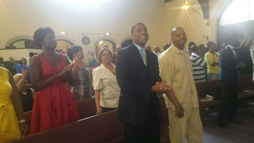 Exavier Pope with Pastor James Brooks during praise and worship.