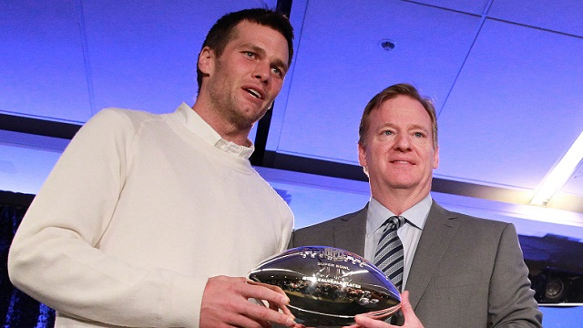 Feb 2, 2015; Phoenix, AZ, USA; New England Patriots quarterback Tom Brady (left) and NFL Commissioner Roger Goodell pose with the Pete Rozelle trophy during the Super Bowl XLIX-Winning Head Coach and MVP Press Conference at Media Center-Press Conference Room B. Mandatory Credit: Joe Camporeale-USA TODAY Sports