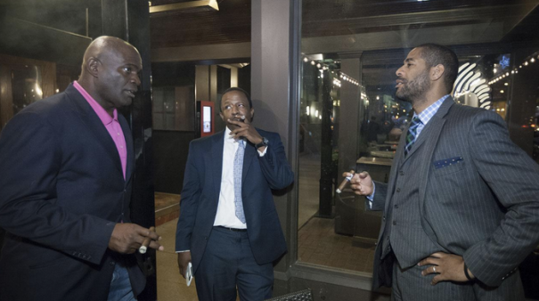 Lawrence Taylor, Realtor Dwayne Hirsh, and Exavier Pope discuss over cigars LT's dominant football career and the business of the game. (Photo: Thuzio)