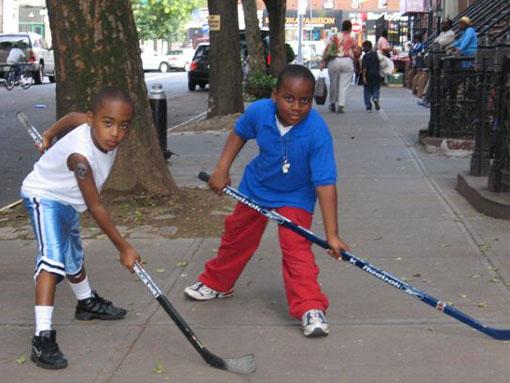 black-kids-hockey-sticks